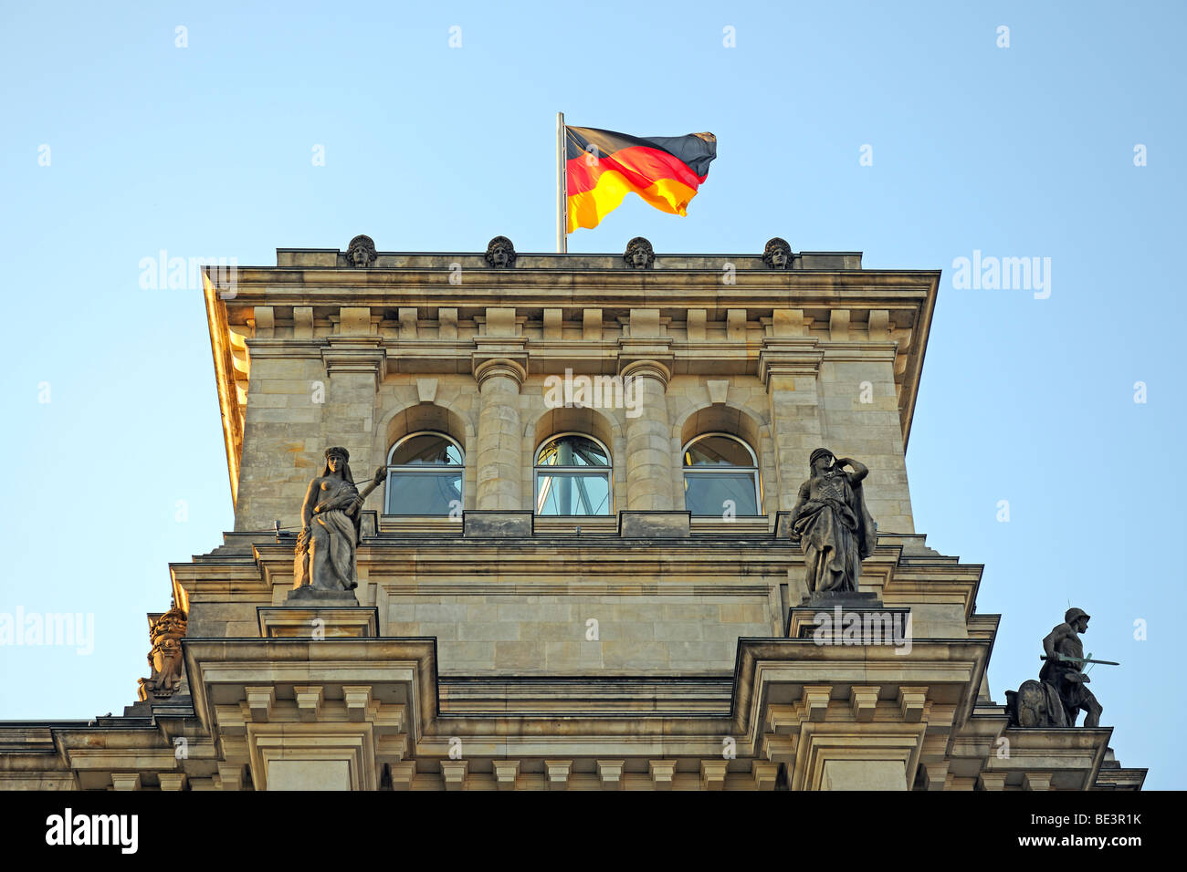 Flag of Germany on one of the towers of the Reichstag building in Berlin, Germany, Europe Stock Photo