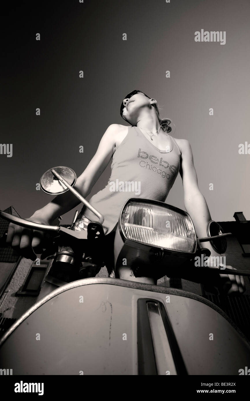 Girl on a motor scooter - Stock Image