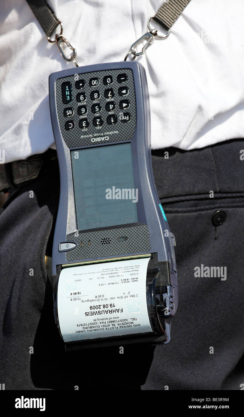 Porter with Casio Handheld Printer Terminal, finished ticket in the printer, harbor cruise, Duisburg-Ruhrort, North - Stock Image