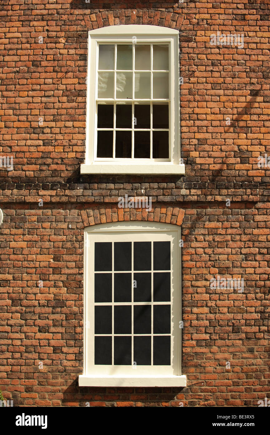 A small Georgian era house in Montgomery Powys wales with a blocked up window to avoid paying the window tax - daylight - Stock Image