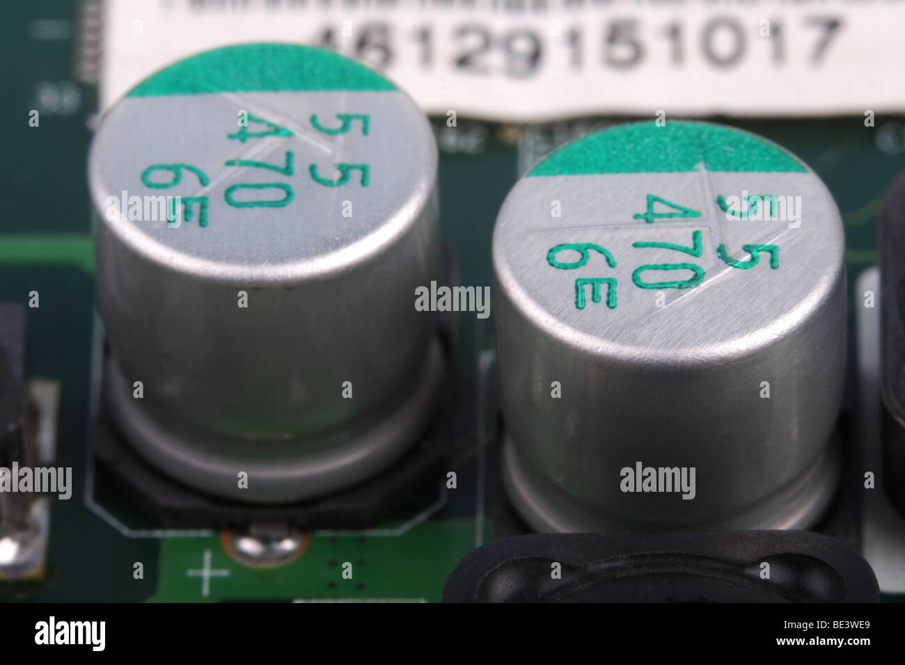 Electronic components on a wiring board shown in a very close up macro. - Stock Image
