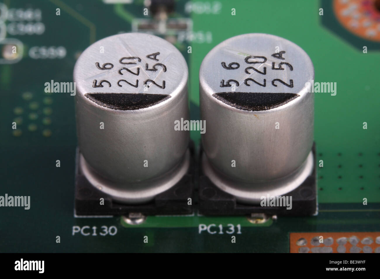 Motherboard capacitors on a macro view with shallow depth of field. - Stock Image
