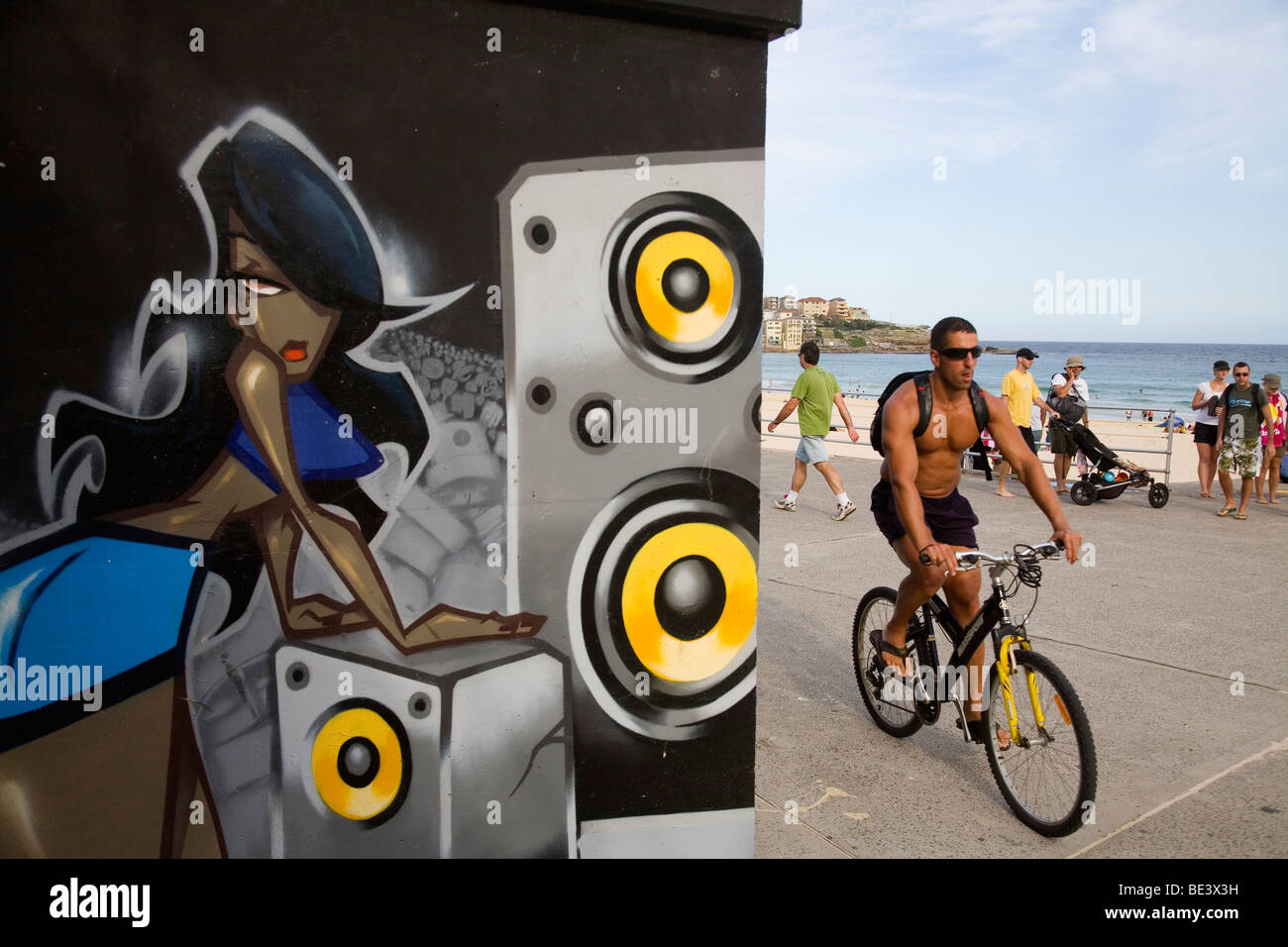 Graffiti artwork and locals on the promenade at Bondi Beach. Sydney, New South Wales, AUSTRALIA - Stock Image