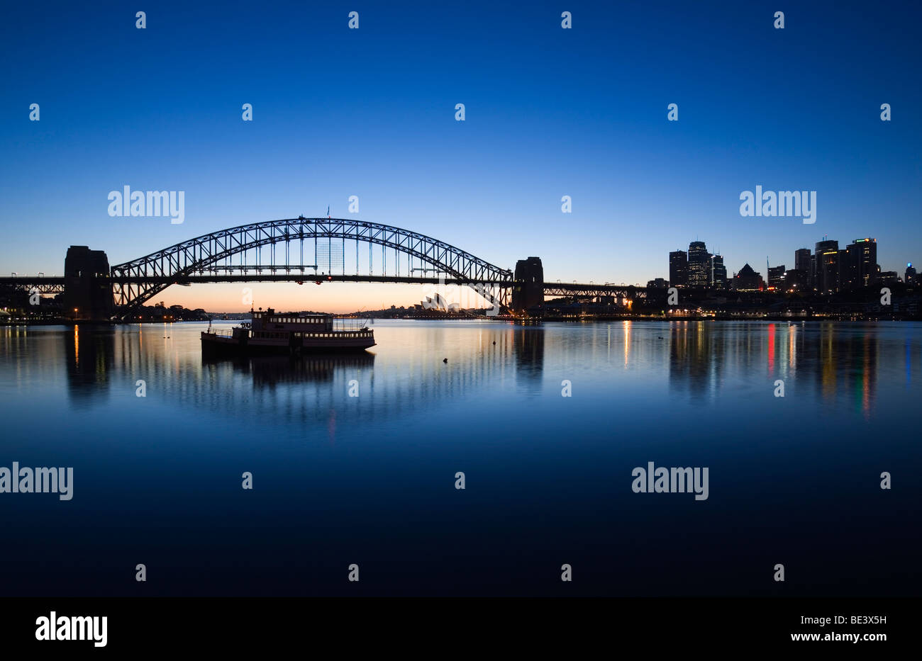 View across Lavendar Bay to the Sydney Opera House and Harbour Bridge at dawn. Blues Point, Sydney, New South Wales, - Stock Image