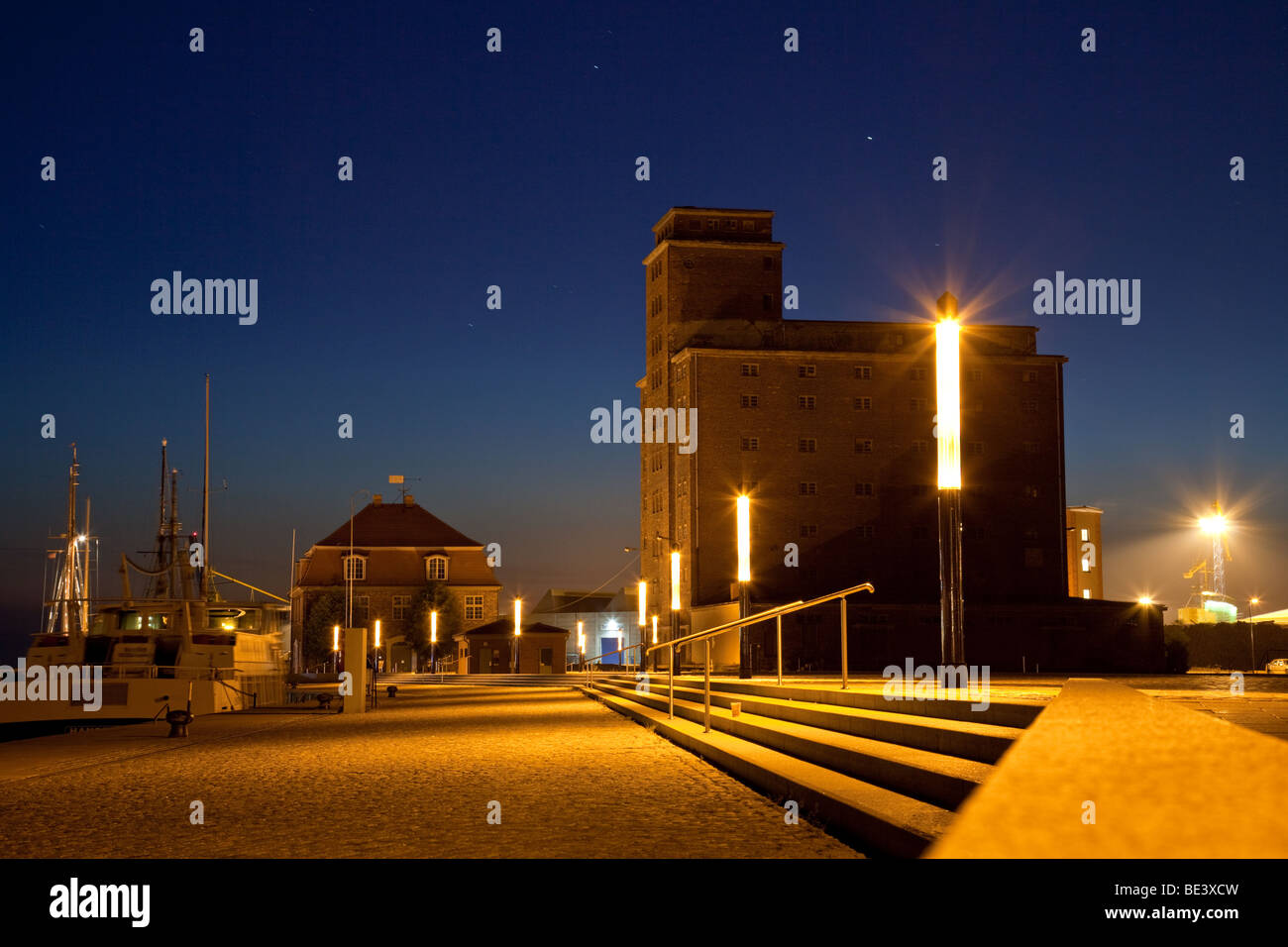 Storehouse in the old harbor of Wismar, Germany, by night - Stock Image
