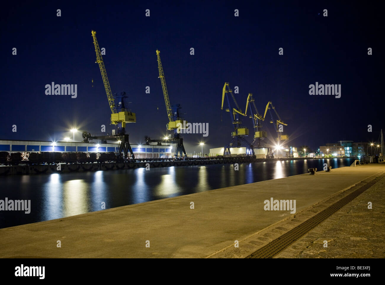 Cranes in the harbor of Wismar, Germany, during Blue hour - Stock Image