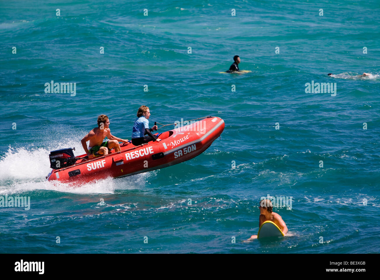 Surf lifesavers practice their surf rescue skills at Manly Beach. Sydney, New South Wales, AUSTRALIA - Stock Image