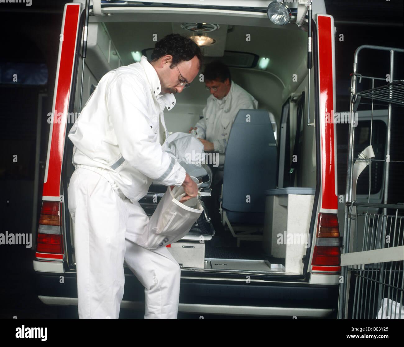 Ambulance medics cleaning the ambulance SerieCVS100023163 - Stock Image