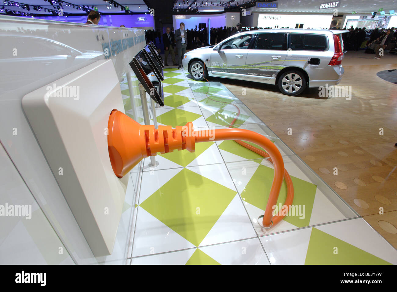 63th International Motor Show ( IAA ): A Volvo is connected symbolially to an oversized plug. Advert for hybride - Stock Image