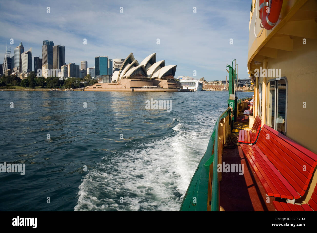 View of the Opera House and city skyline from the deck of a Sydney ferry. Sydney, New South Wales, AUSTRALIA - Stock Image