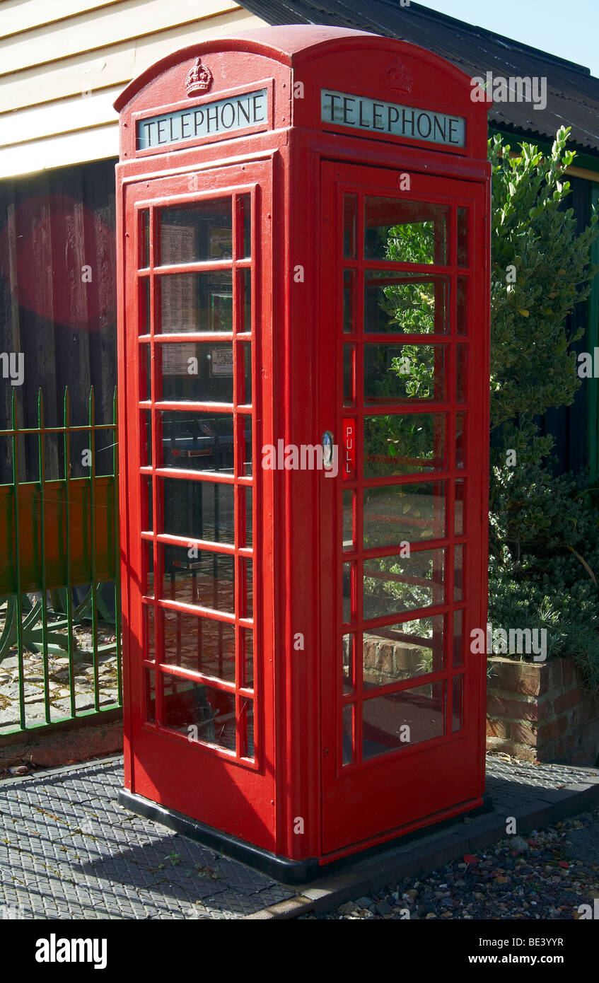 Red K6 phone box with button A & B phone at Ropley on the Mid-Hants Railway in Hampshire, England. - Stock Image