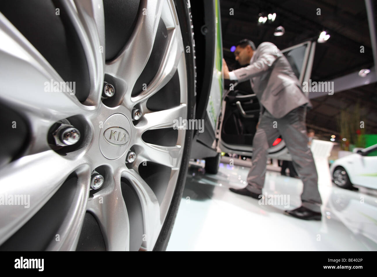 63th International Motor Show ( IAA ): A visitor is interested in a car of the manufacturer Kia Stock Photo