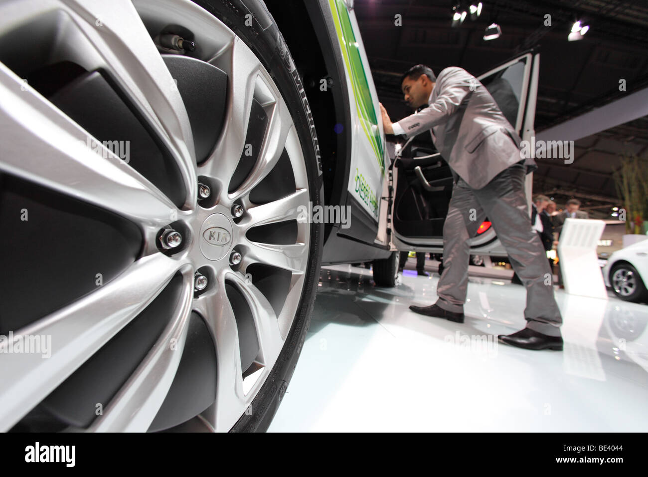 63th International Motor Show ( IAA ): A visitor is interested in a car of the manufacturer Kia - Stock Image