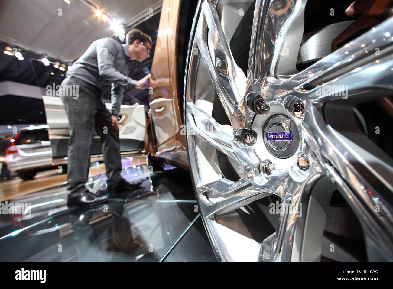 63th International Motor Show ( IAA ): A visitor is interested in a car of the manufacturer Volvo. - Stock Image