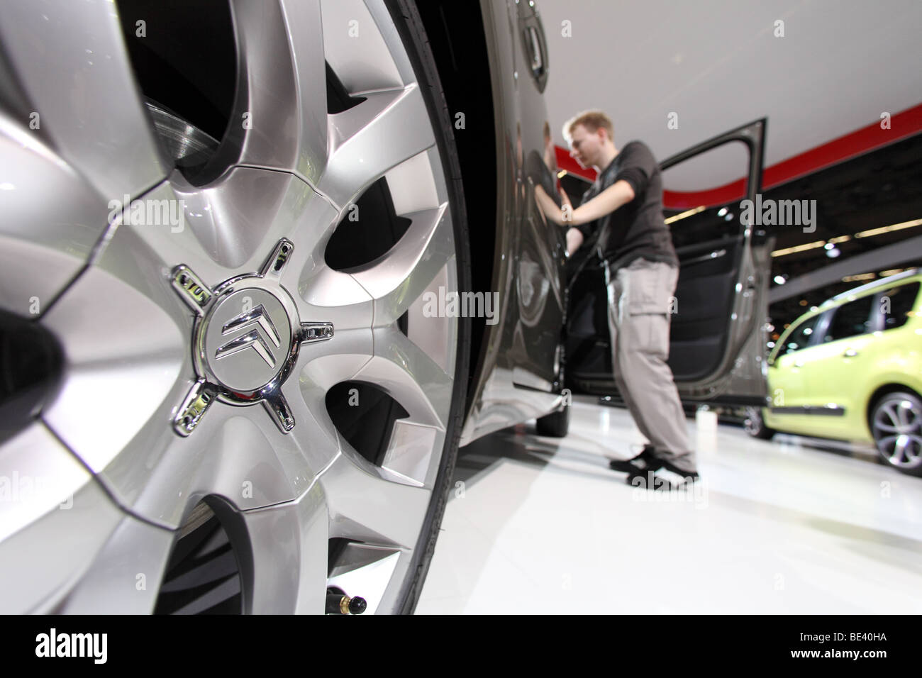 63th International Motor Show ( IAA ): A visitor is interested in a car of the manufacturer Citroen - Stock Image