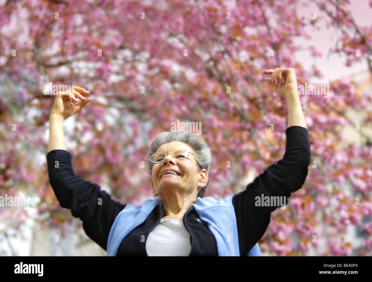 Seniorin in Bonn freut sich ueber den Fruehling Stock Photo