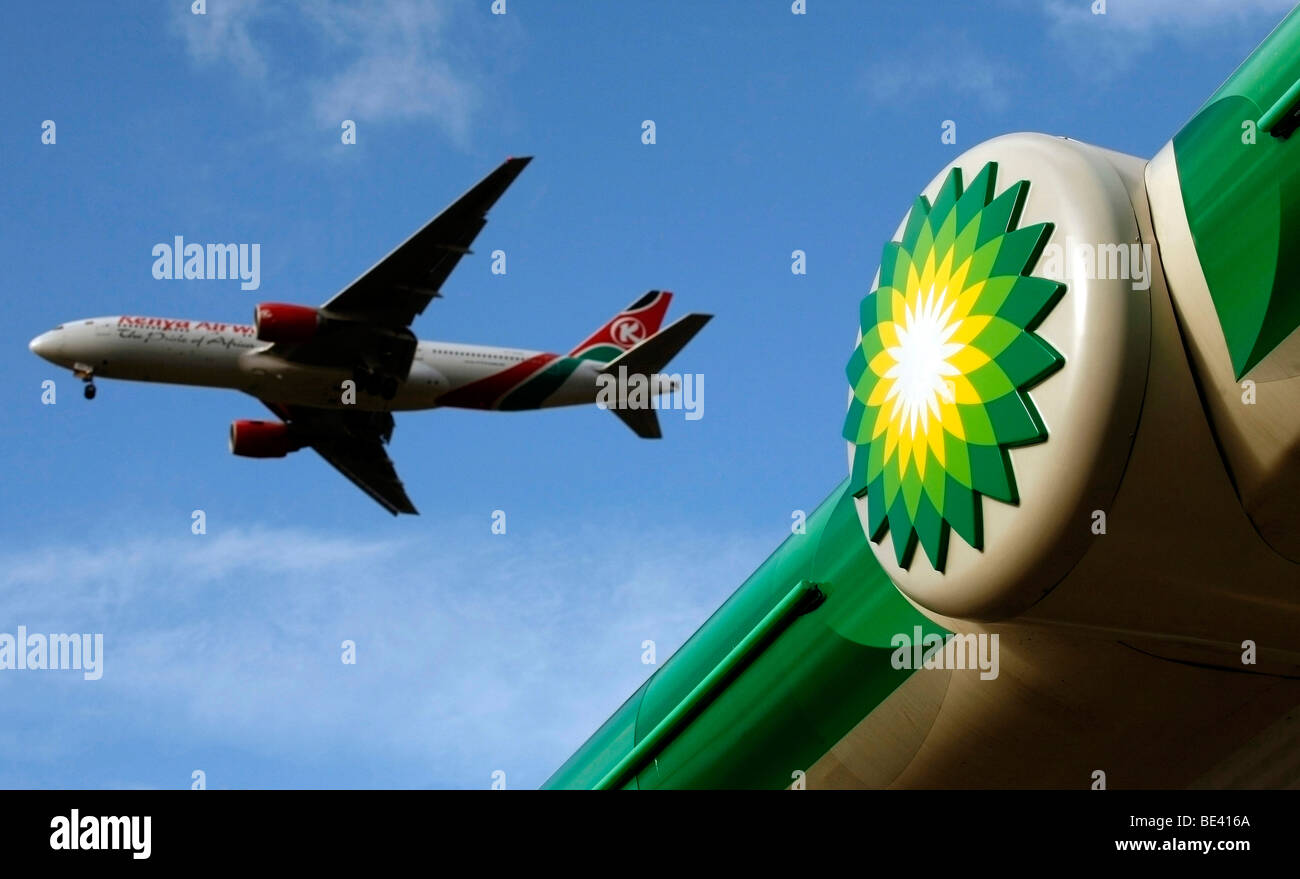 kenya air ways aeoplane flys past a Shell Petrol station as it leaves heathrow airport in west london Stock Photo
