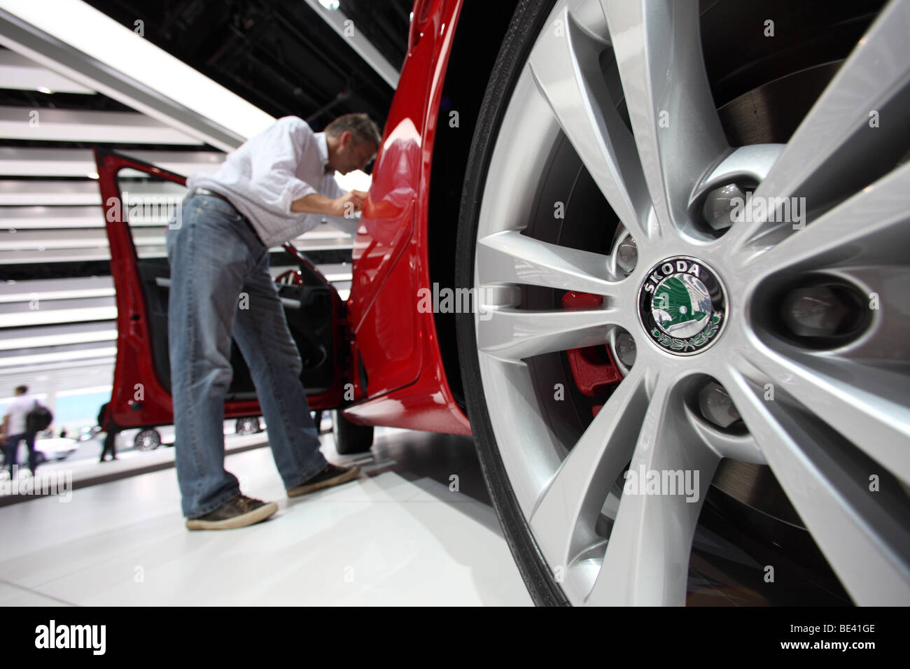 63th International Motor Show ( IAA ): A visitor is interested in a car of the manufacturer Skoda - Stock Image