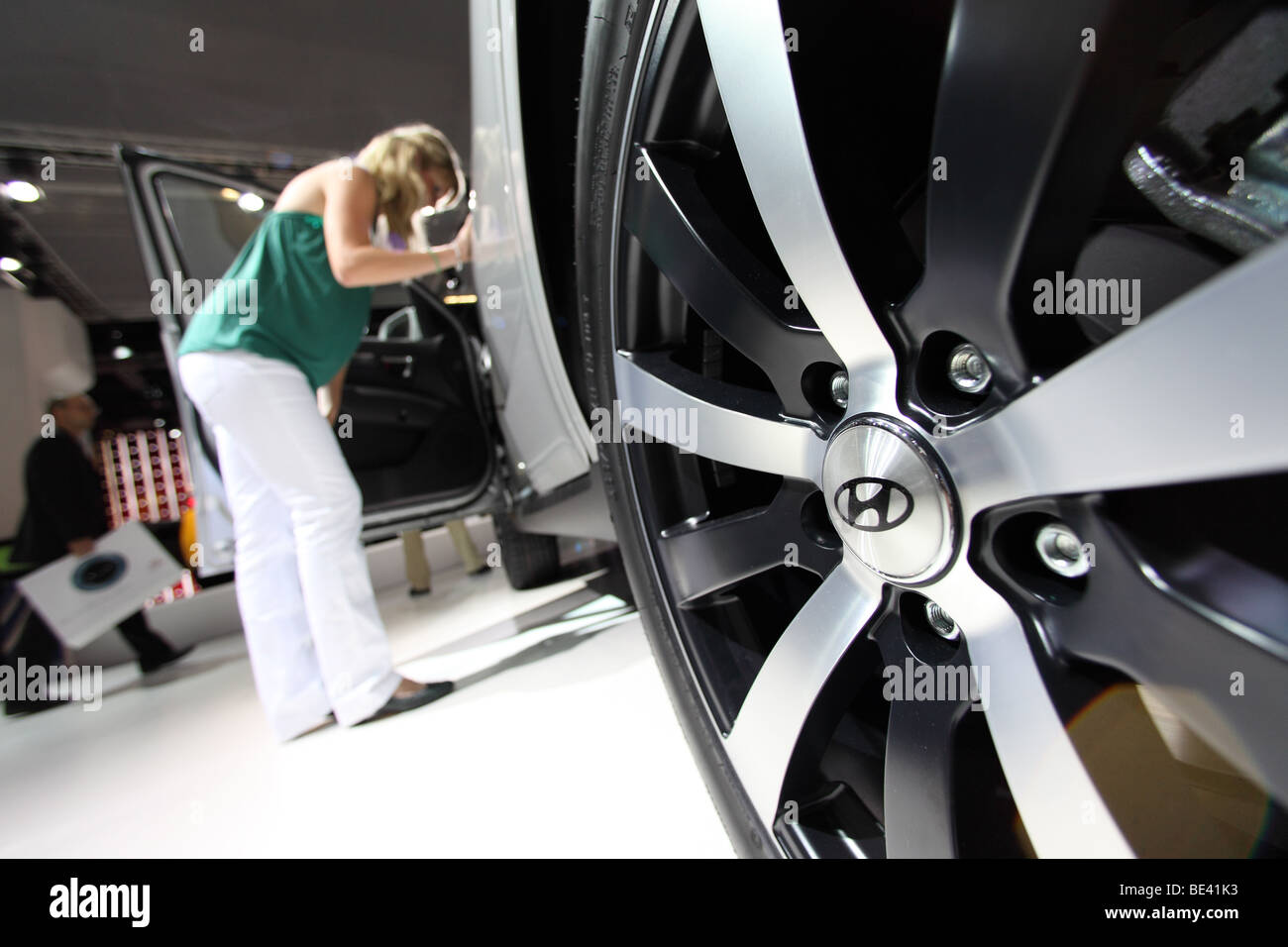63th International Motor Show ( IAA ): A visitor is interested in a car of the manufacturer Hyundai - Stock Image