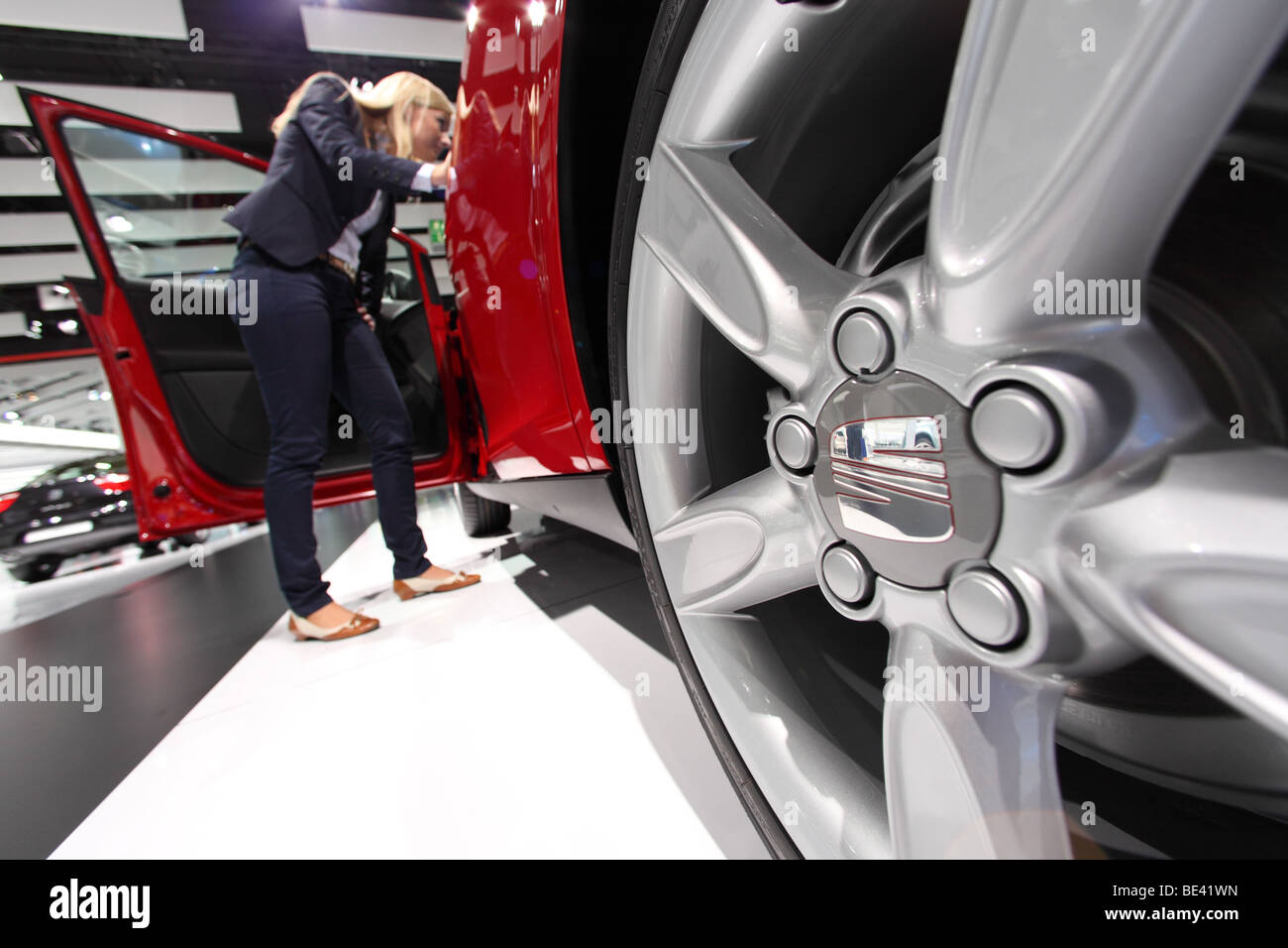63th International Motor Show ( IAA ): A visitor is interested in a car of the manufacturer Seat - Stock Image