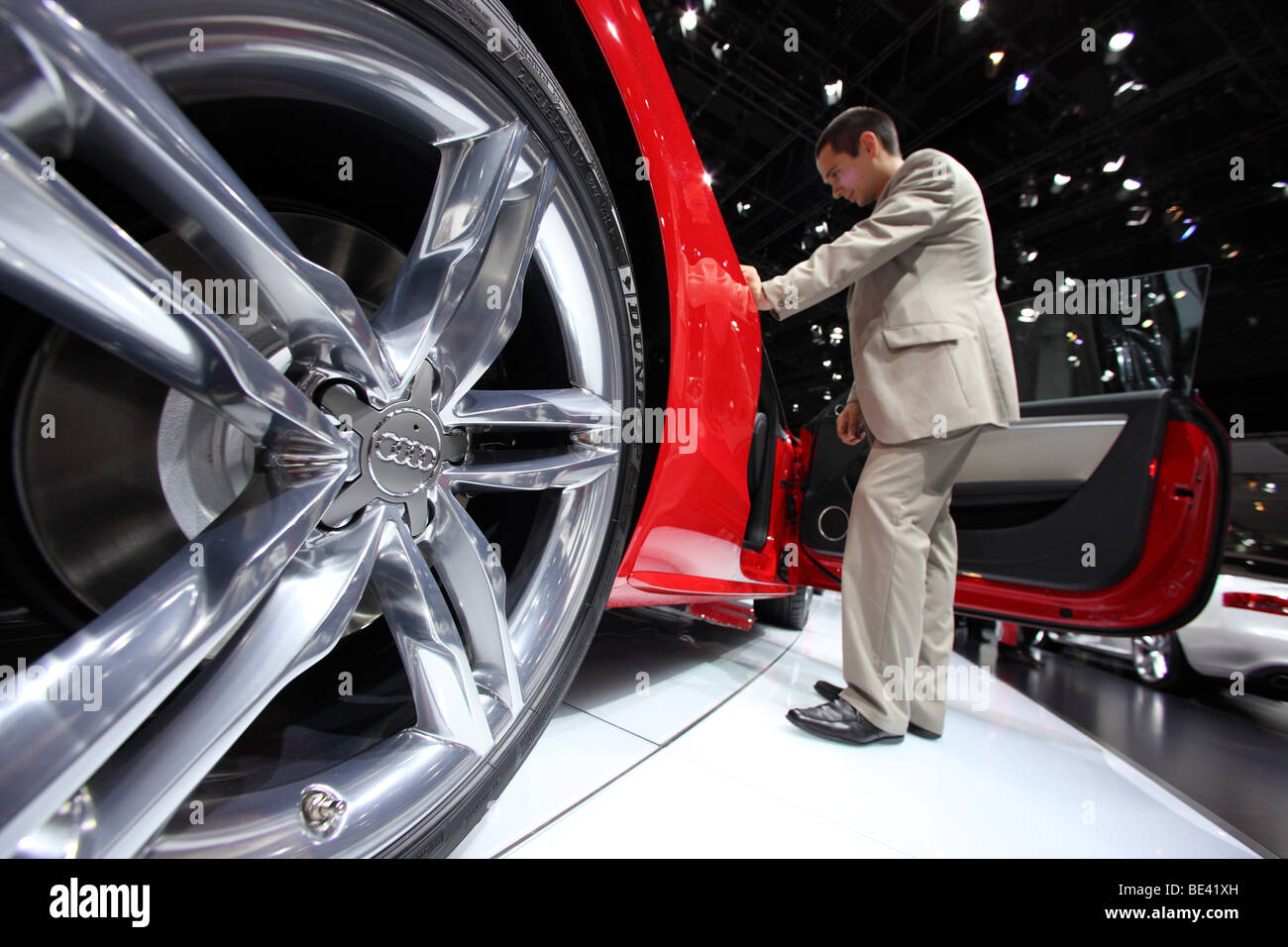 63th International Motor Show ( IAA ): A visitor is interested in a car of the manufacturer Audi - Stock Image