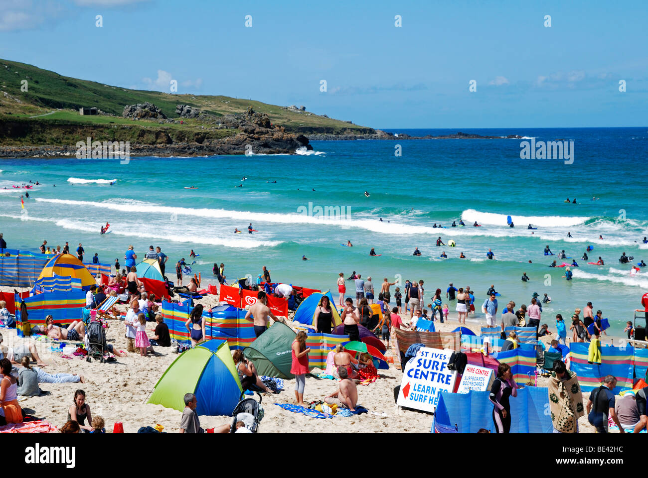 a busy porthmeor beach st.ives cornwall uk in the middle of the summer holidays - Stock Image