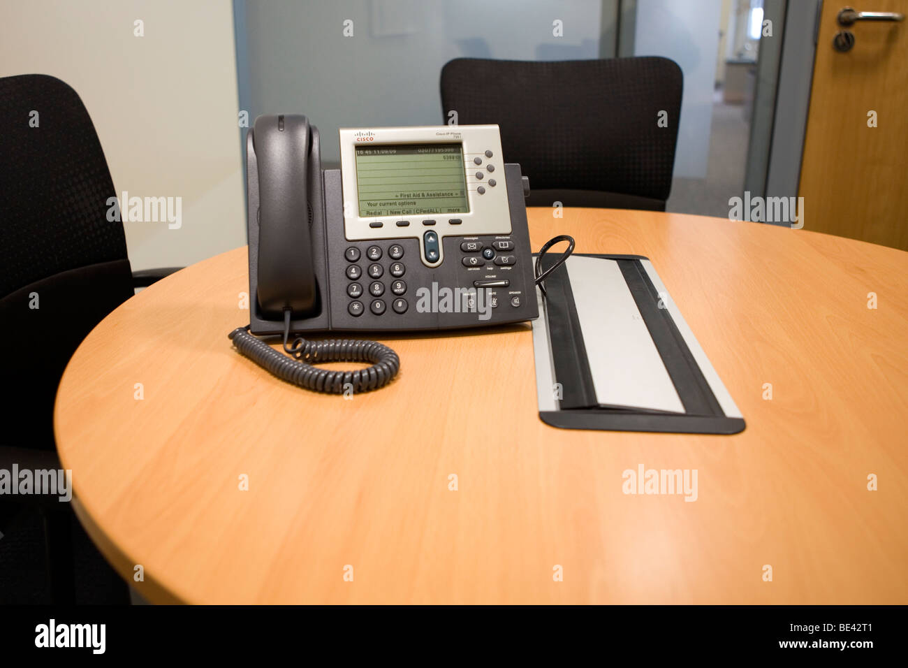 Cisco IP phone on the desk in a meeting room Stock Photo: 25905601