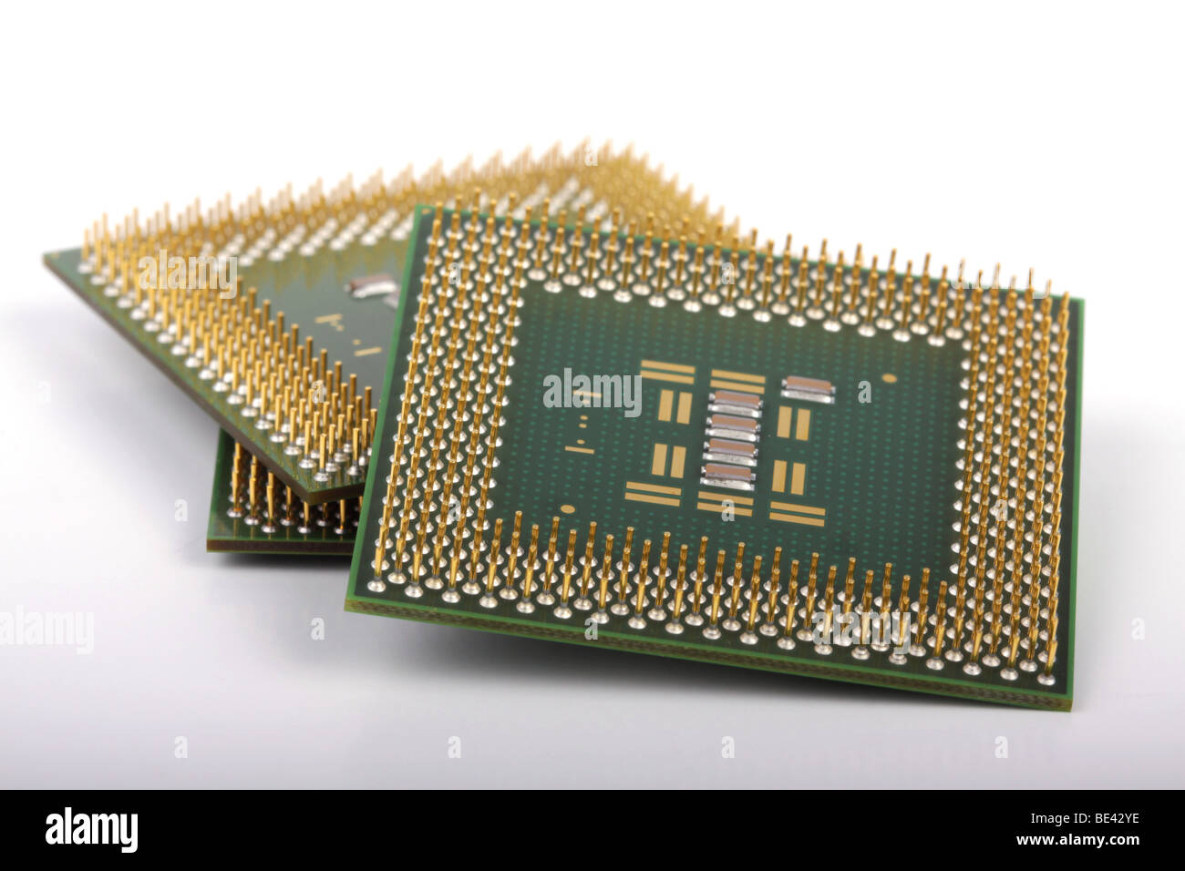 Several computer chips on a white background. - Stock Image