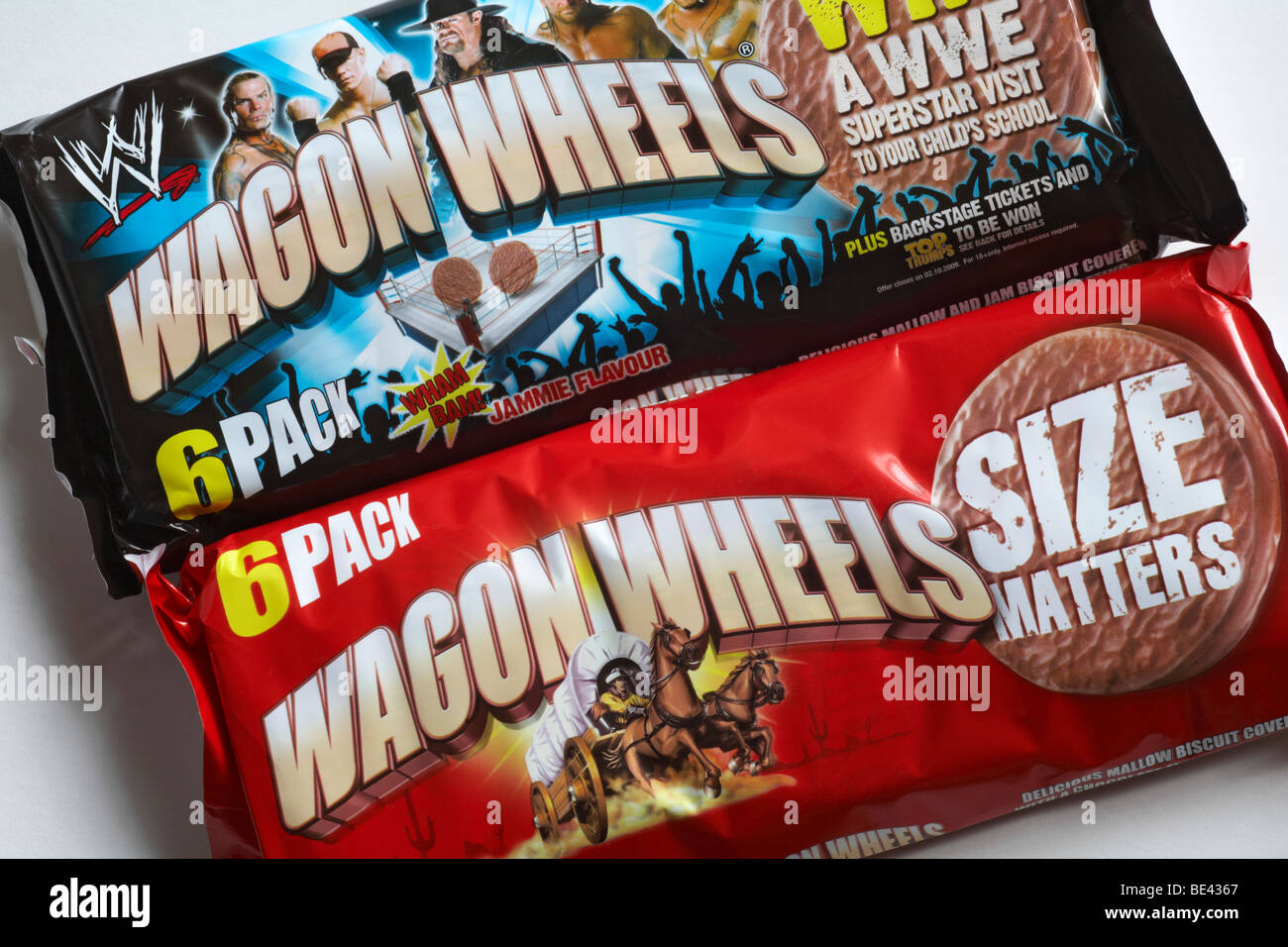 Wagon Wheels biscuits biscuit - 6 pack packets of original plain and jammie flavour Wagon Wheels biscuits Stock Photo