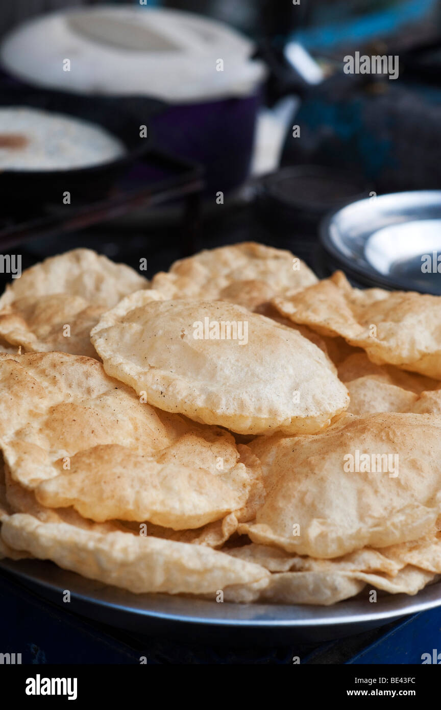 Cooked puri on a street cart in India. Indian street food. Andhra Pradesh, India - Stock Image