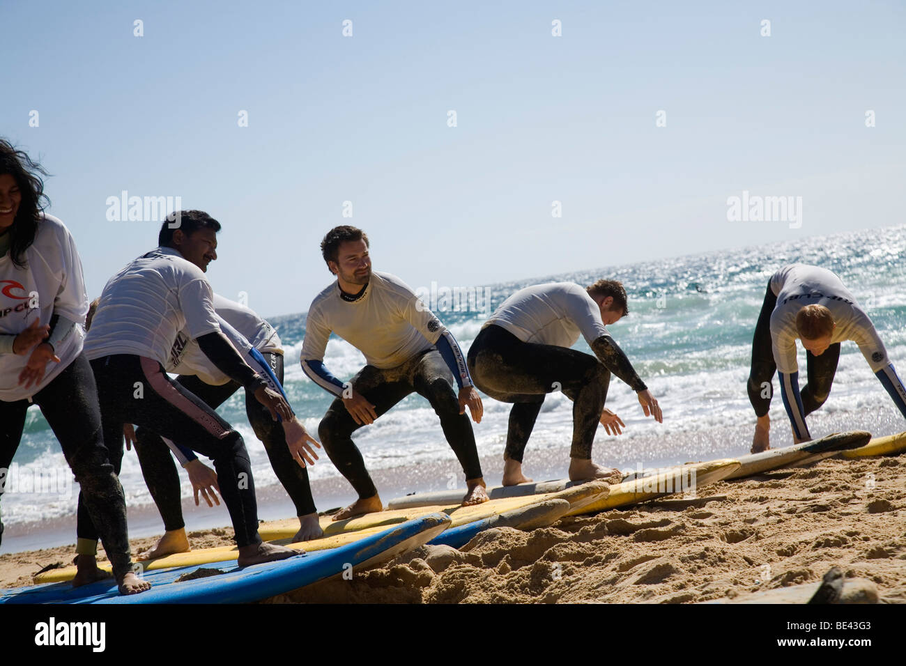 Learning to surf at Surfschool on the sands of Manly Beach. Sydney, New South Wales, AUSTRALIA - Stock Image