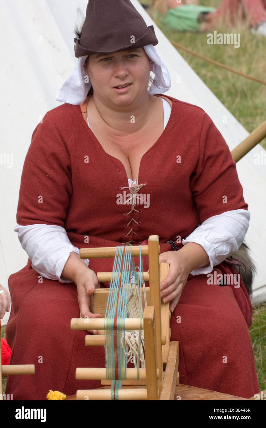 Medieval wool spinner - Stock Image
