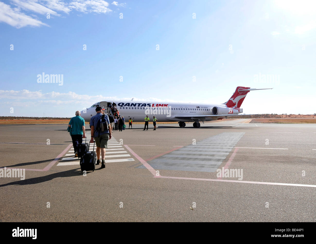 Passengers boarding Qantas Airlines Boeing 717, Ayers Rock Airport, also known as Connellan Airport, Ayers Rock, - Stock Image