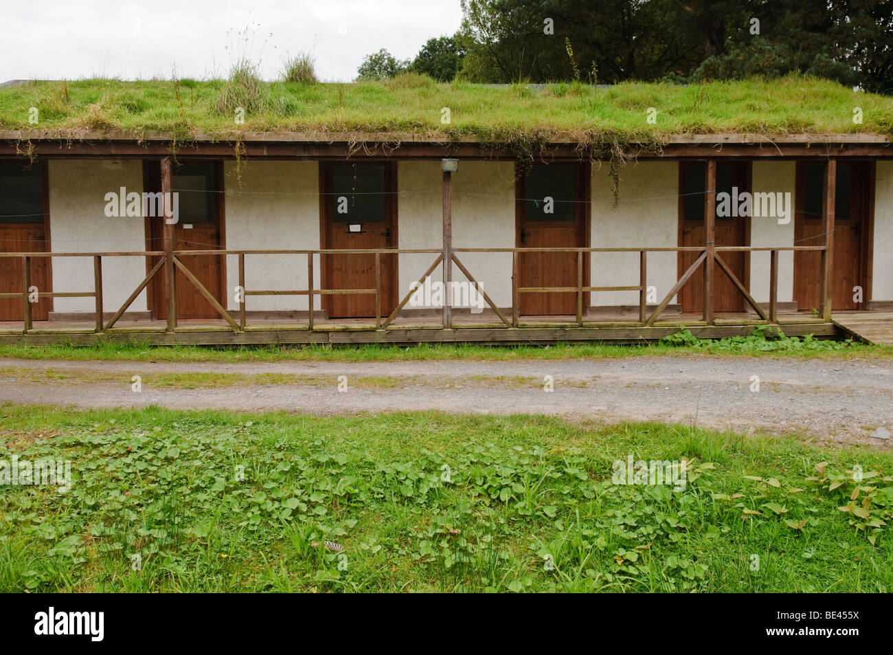Ecological environmentally friendly toilet block with grass roof - Stock Image