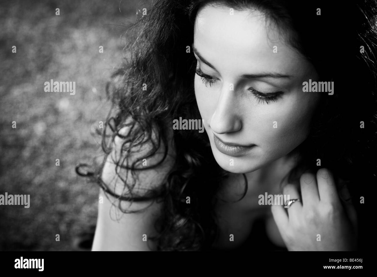 Young woman pensive portrait. Black and white. - Stock Image