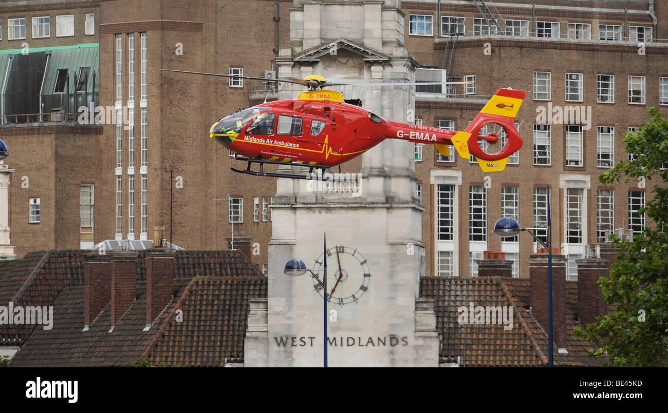 THE WEST  MIDLANDS AIR AMBULANCE  HELICOPTER HOVERS LOW OVER BIRMINGHAM CITY CENTRE,UK - Stock Image
