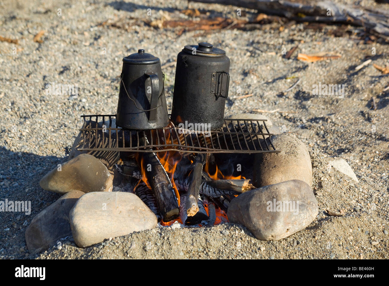 Two kettles on a camp fire, grill, black from soot, tea and coffee, upper Liard River, Yukon Territory, Canada - Stock Image