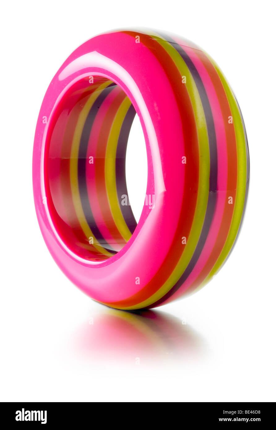 striped bright colored bangle - Stock Image