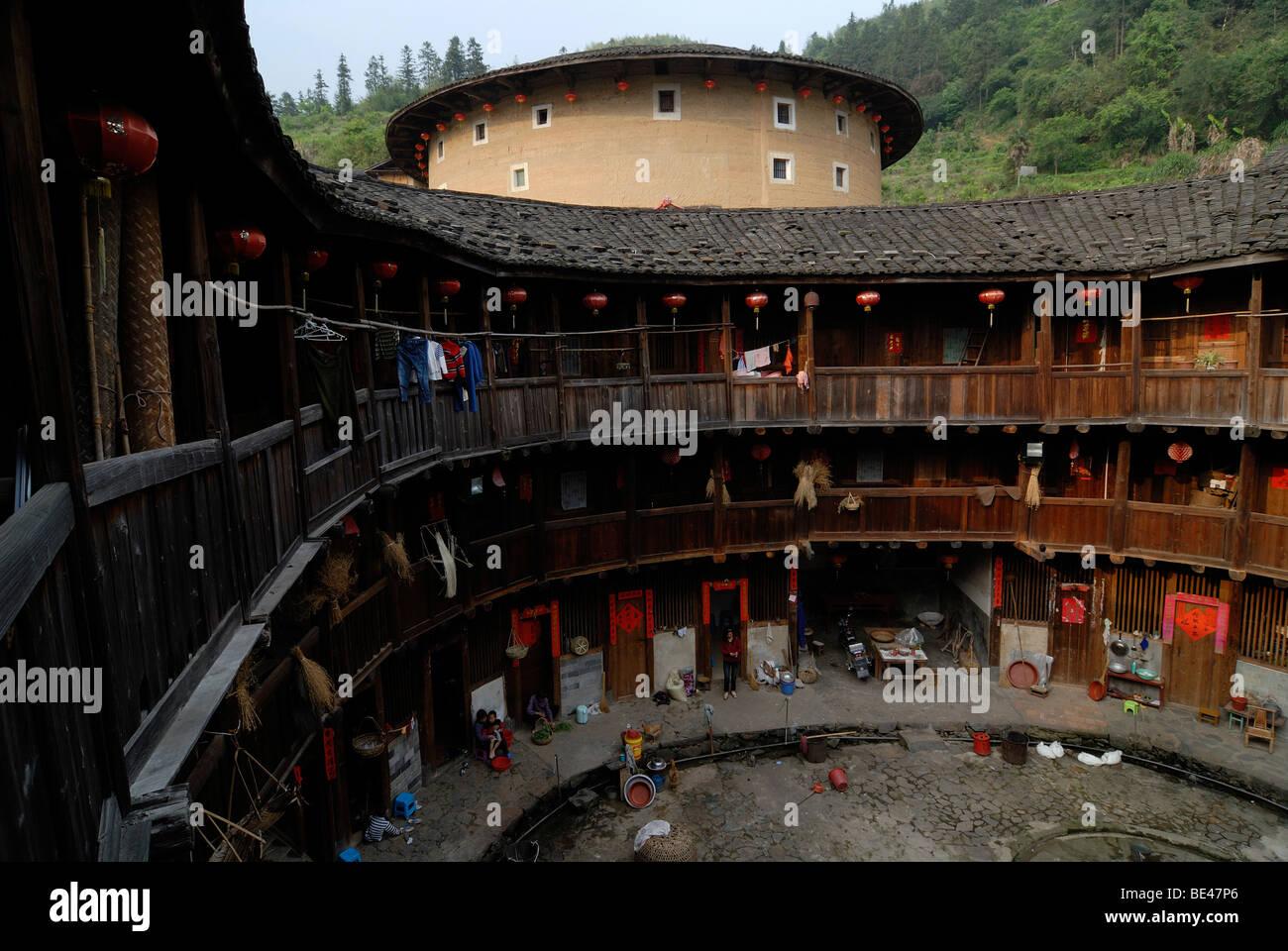 Round courtyard of a Tulou round house, dirt round houses, adobe round houses, the Chinese minority Hakka, near Stock Photo