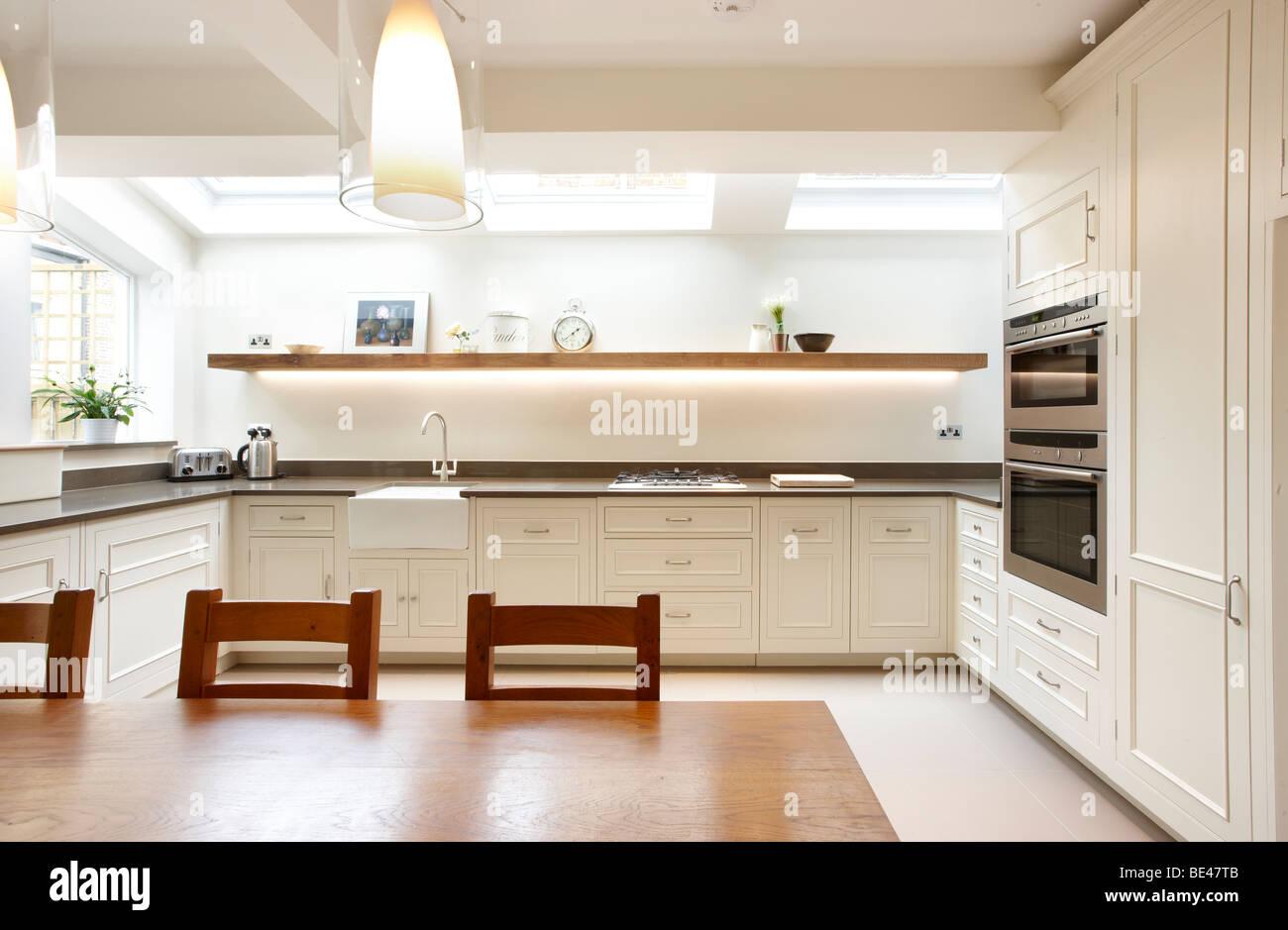 Kitchen side extension London terrace Oak table skylights Velux ...