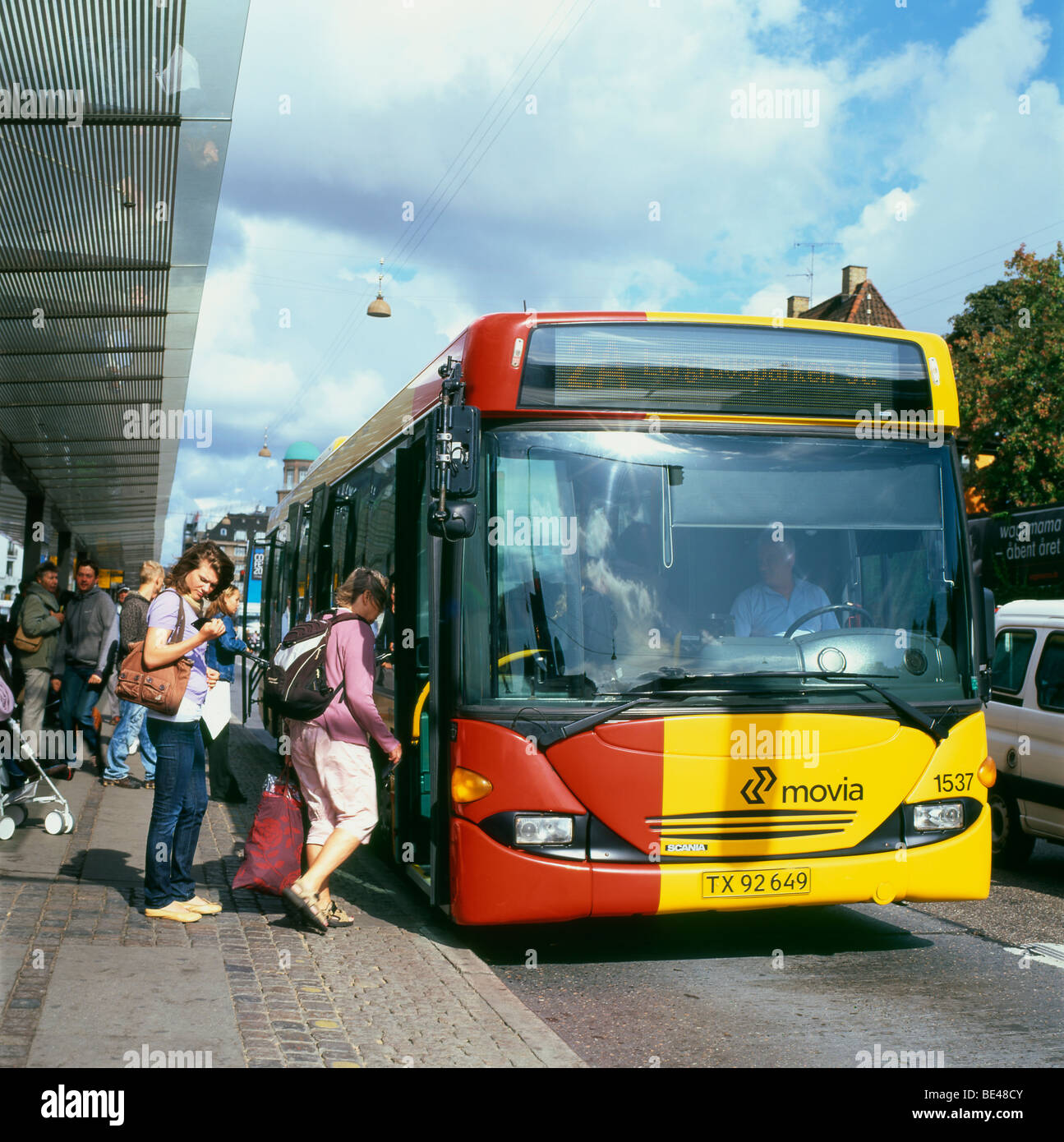 Passengers boarding a bus outside Central Station Hovedbanegarden Copenhagen Denmark  KATHY DEWITT - Stock Image