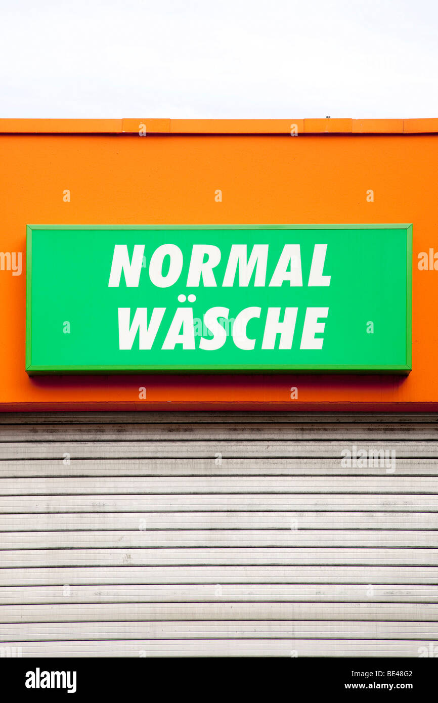 Lettering 'Normal Waesche' normal wash on a car wash in Neutraubling, Bavaria, Germany, Europe - Stock Image