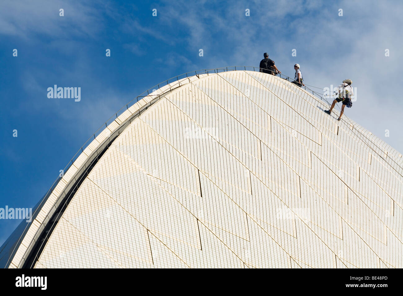 Workers scale the Opera House roof to carry out repairs.  Circular Quay, Sydney, New South Wales, AUSTRALIA - Stock Image