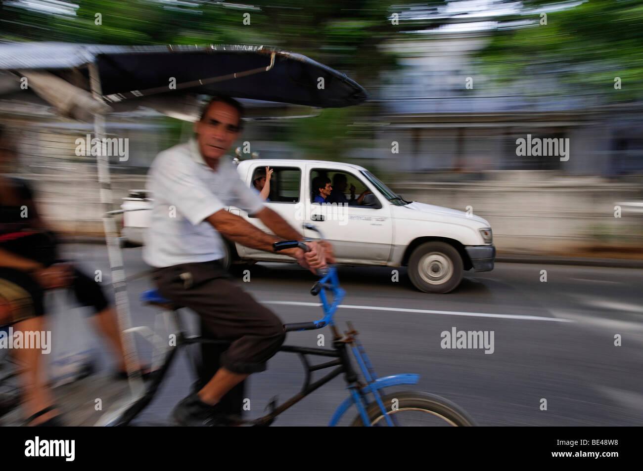 Cycle taxi motion blur, Havana, Cuba - Stock Image