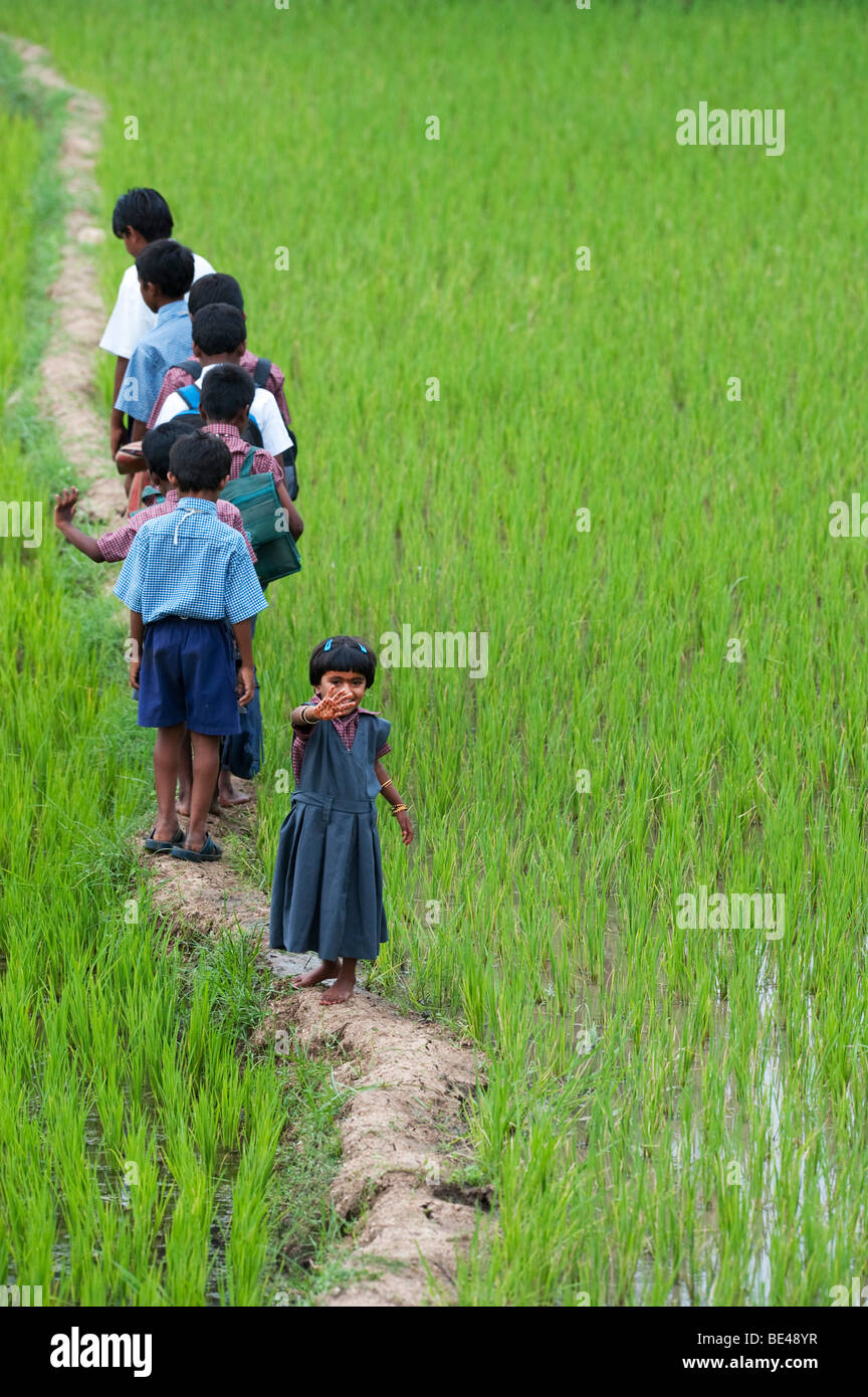 Little Indian Girl Waving At The Back Of A Line Of Indian