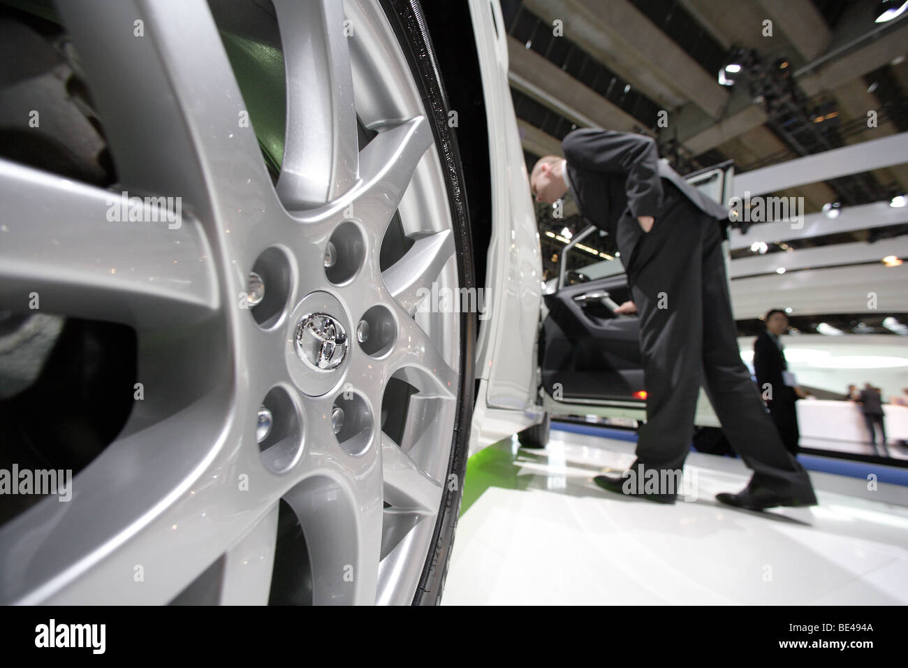 63th International Motor Show ( IAA ): A visitor is interested in a car of the manufacturer Toyota - Stock Image