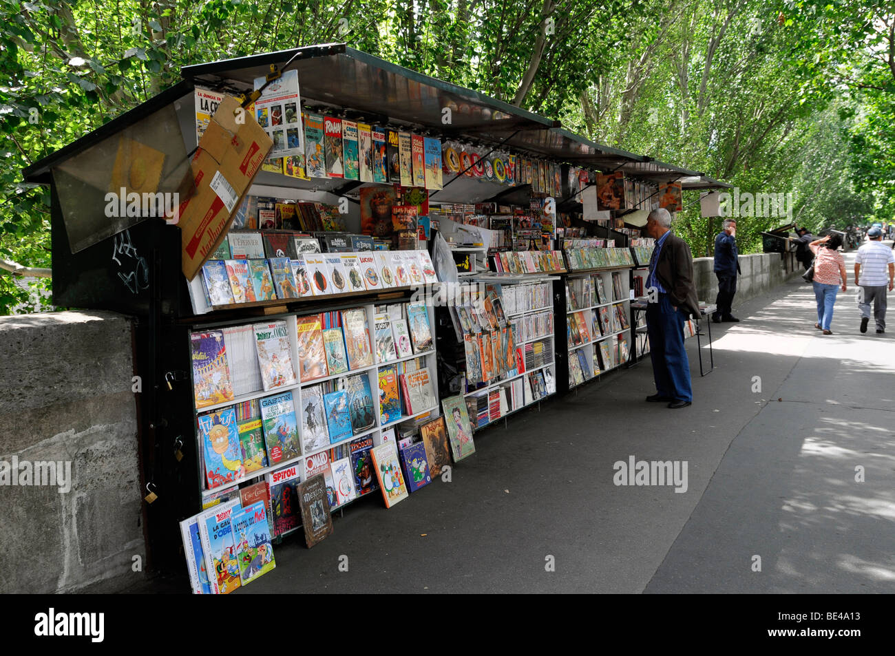 Booksellers on the Seine promenade, book and souvenir shops on the river Seine, Paris, France, Europe - Stock Image