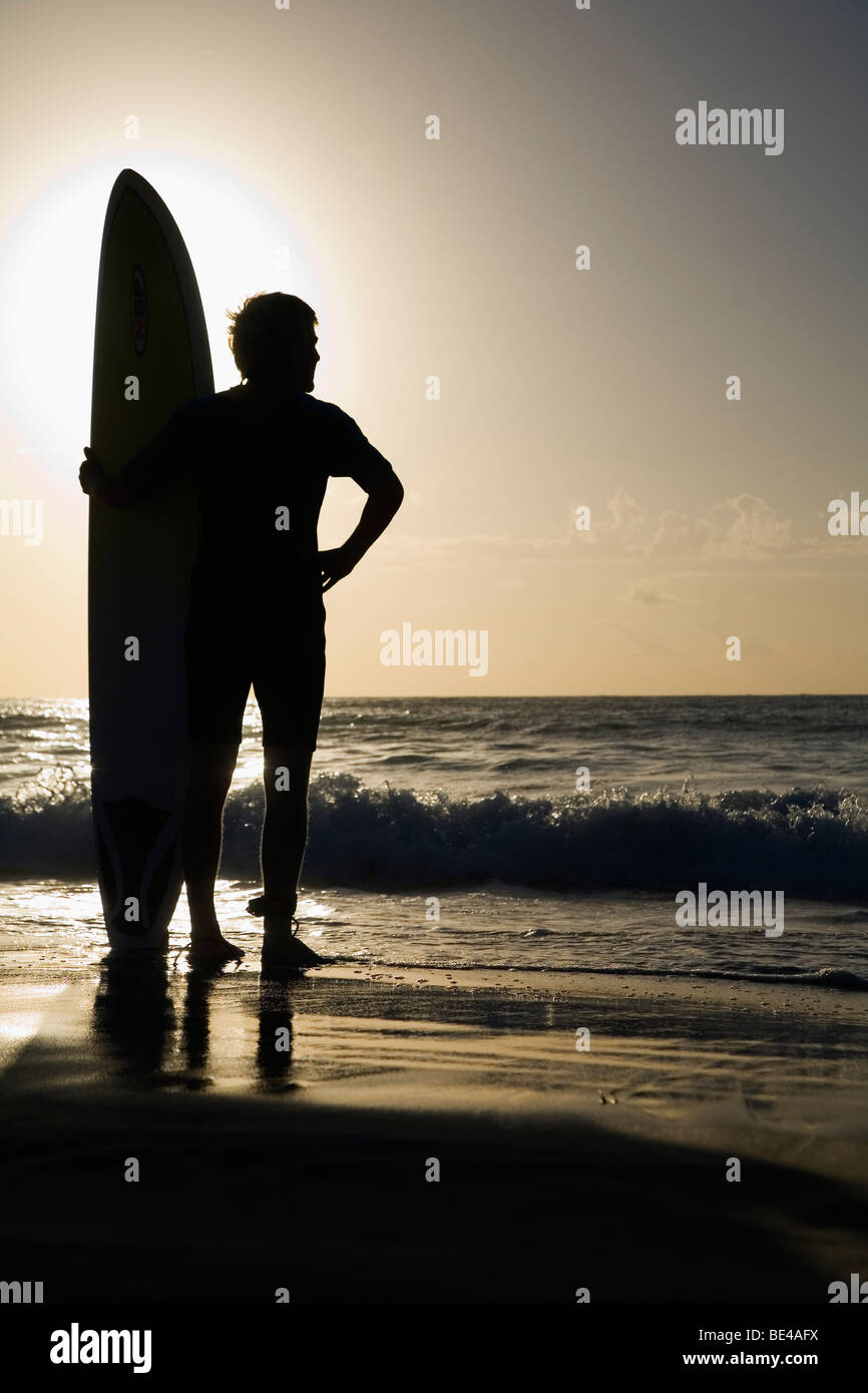 A surfer looks out to the waves at Bondi Beach. Sydney, New South Wales, AUSTRALIA - Stock Image
