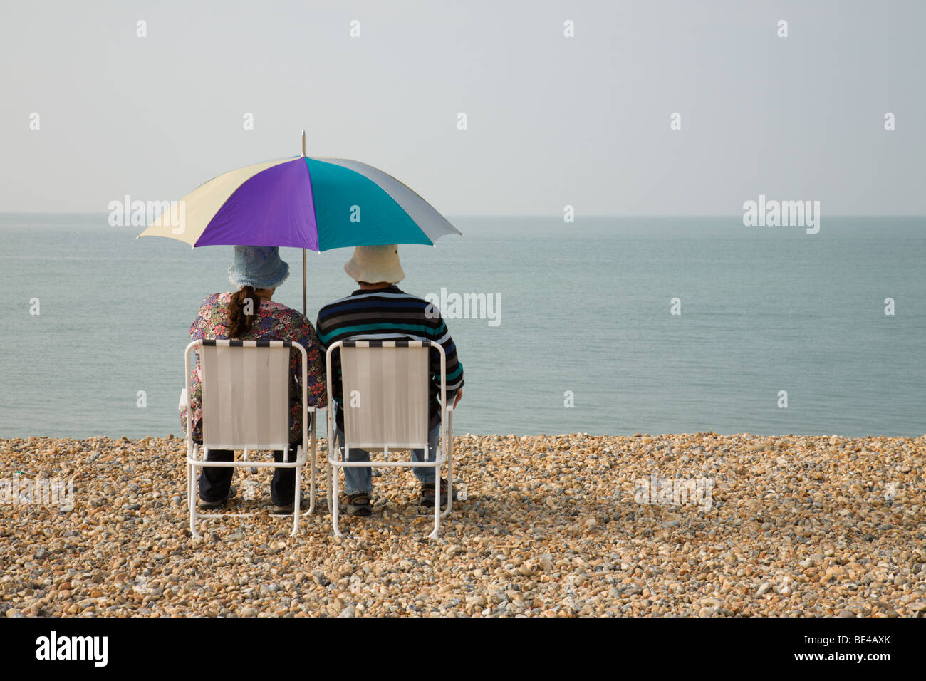 A couple sharing the moment. - Stock Image