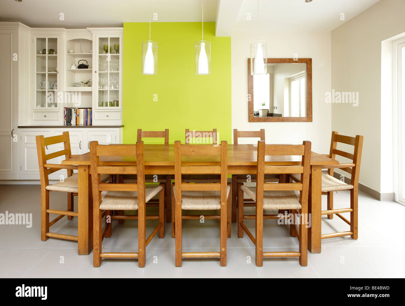 Kitchen side extension London terrace Oak table skylights Velux feature green wall - Stock Image